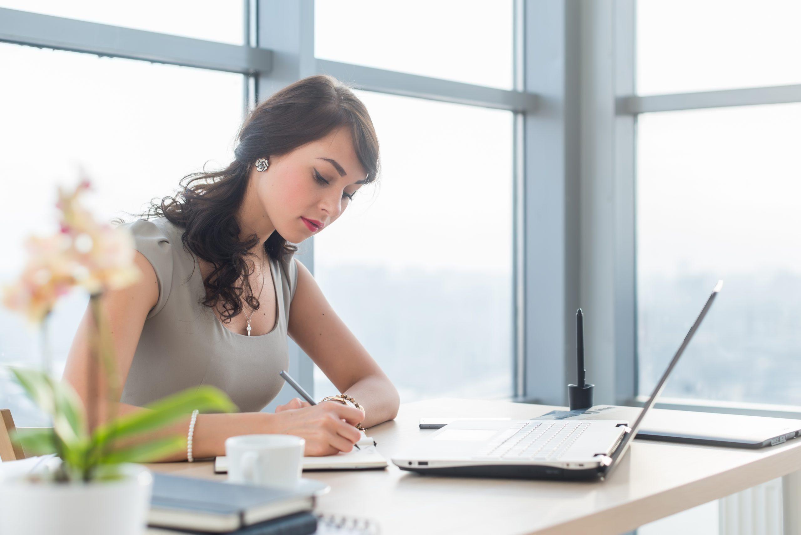 Woman Writing a Eulogy